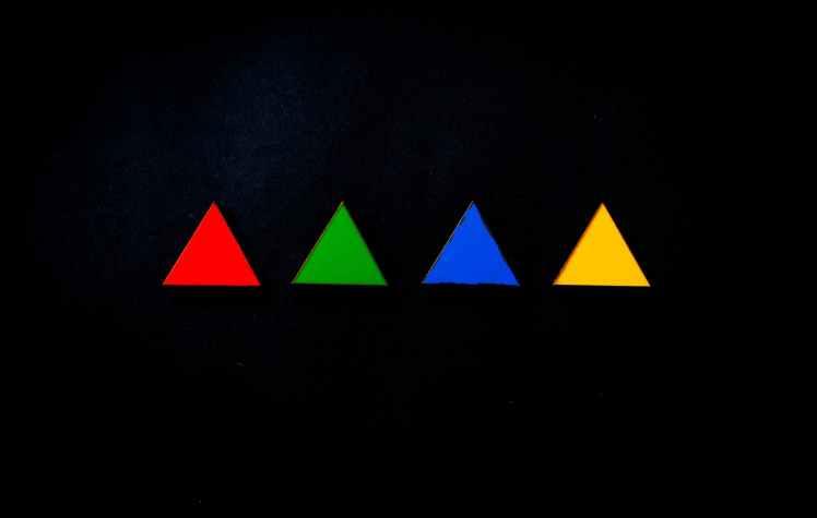 four assorted colour triangles